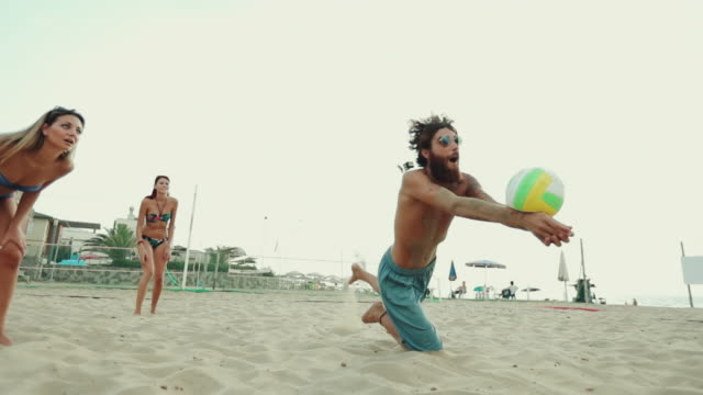 Friends play beach volley and have fun Friends play beach tennis and have fun volleyball sport stock videos & royalty-free footage