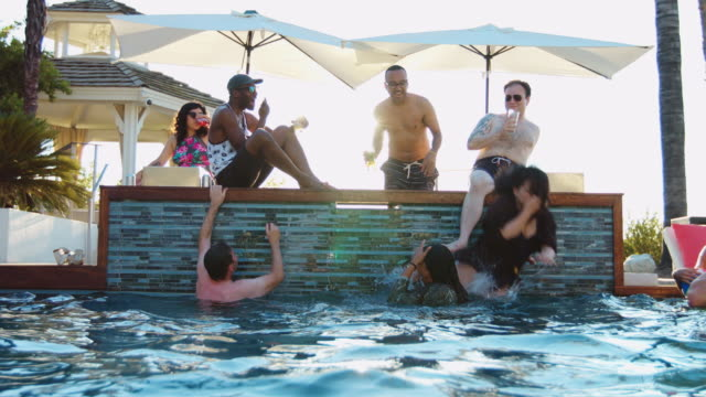 Friends Playing Around On Poolside video