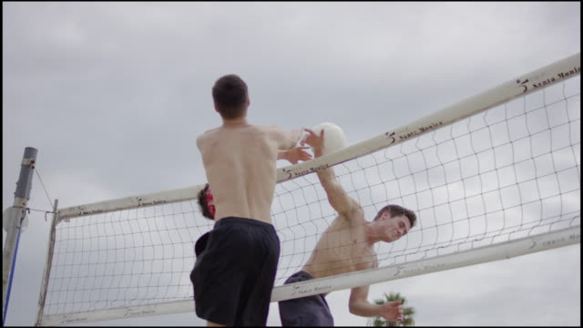 Friends playing beach volleyball video