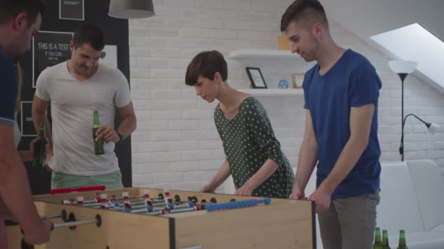 Friends Playing Foosball At Home. video