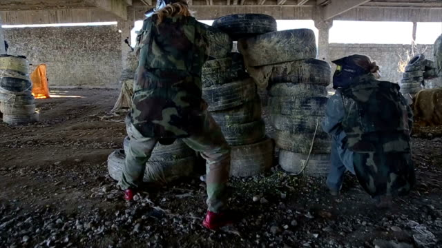 Friends playing paintball video