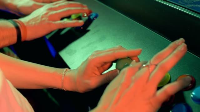 vídeos de stock e filmes b-roll de friends playing video arcade machines - man joystick