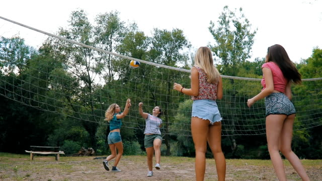 friends playing volleyball at public park - volleyball stock videos and b-roll footage