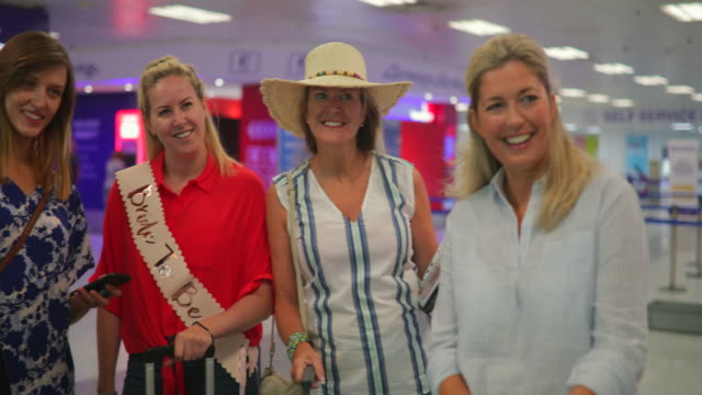 friends posing for picture in airport - bachelorette party stock videos & royalty-free footage