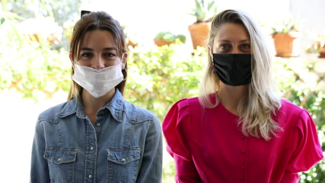 Friends posing looking at camera with protective face mask video