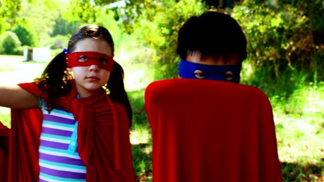 Friends pretending to be a superhero in park video