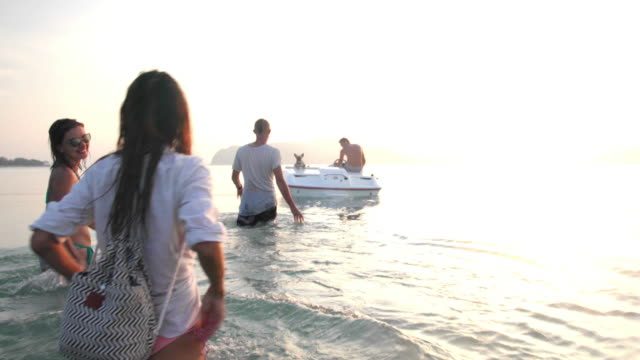 friends riding speedboat 4k - affluent lifestyle stock videos and b-roll footage