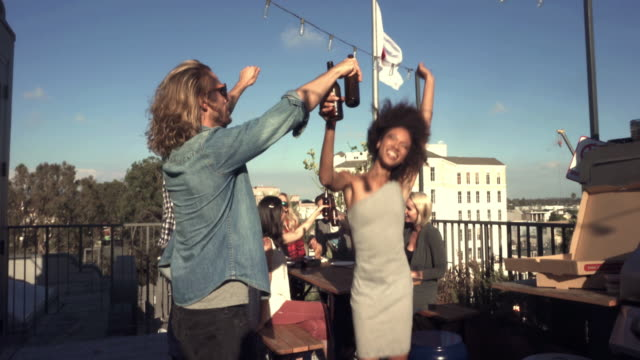 MONTAGE - Friends Roof Cheers Selfie Pizza Party Loft Outdoor California. video