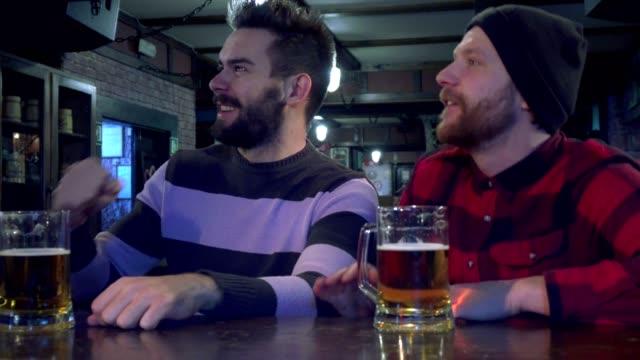 Friends root at pub video