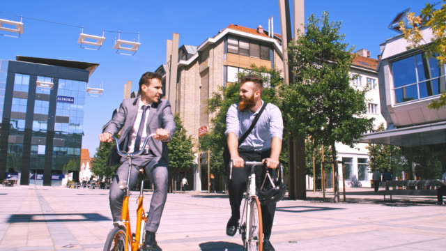 SLO MO Friends separate while riding with bicycles in the city