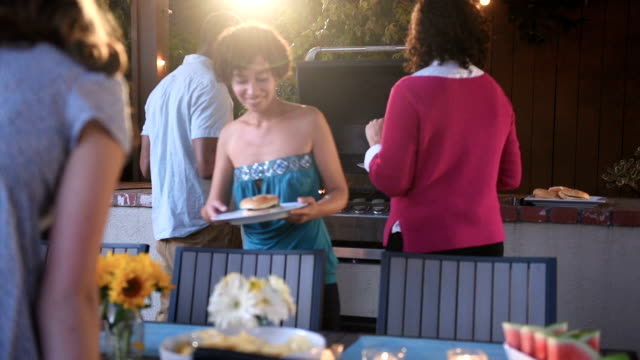 Friends Serve Themselves at a Summer BBQ video