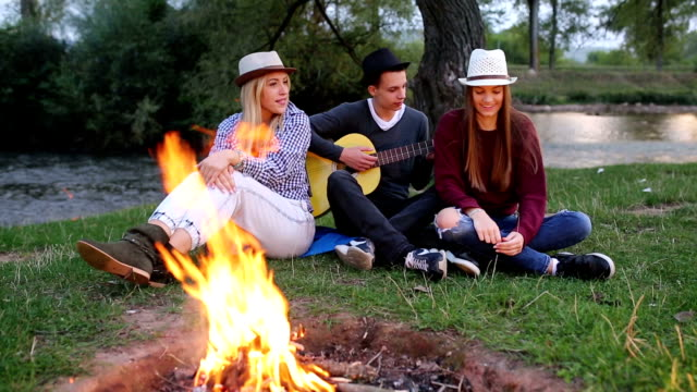 Friends singing by fire video