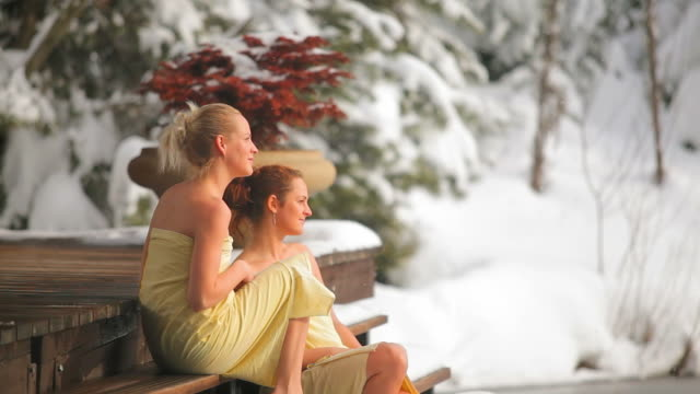 Friends sit in beautiful nature together  wearing a towel stock videos & royalty-free footage