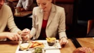 istock Friends sitting in restaurant and having dinner. 1191392801