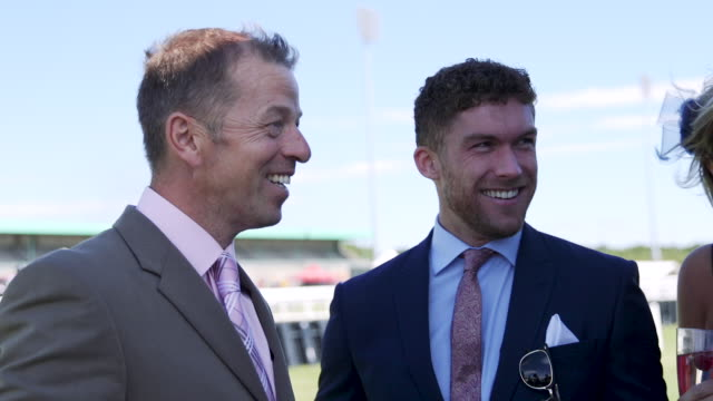 Friends Socialising at The Race Course Friends are drinking alcohol at the horse racecourse. formalwear stock videos & royalty-free footage