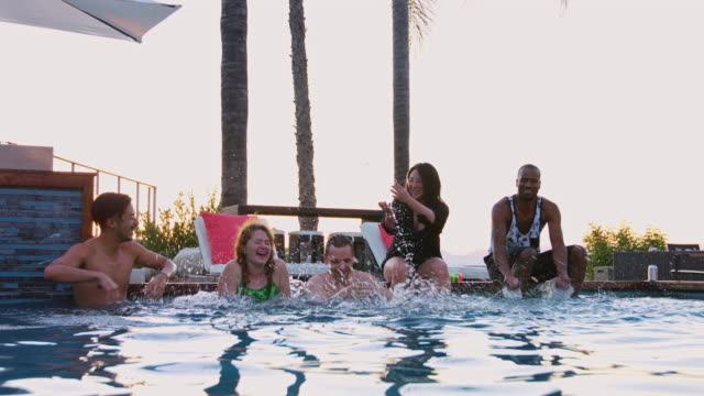Friends Splashing Each Other in Swimming Pool video