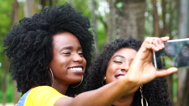 Friends taking a selfie Friends taking a selfie curly hair stock videos & royalty-free footage