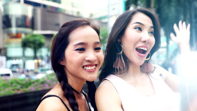 Friends taking selfies and video call during a trip in Bangkok video