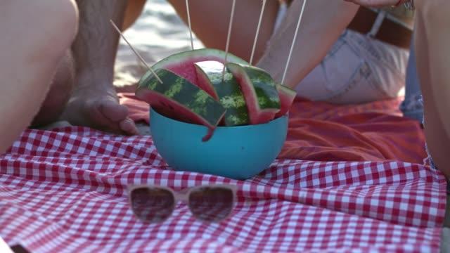Friends taking watermelon video