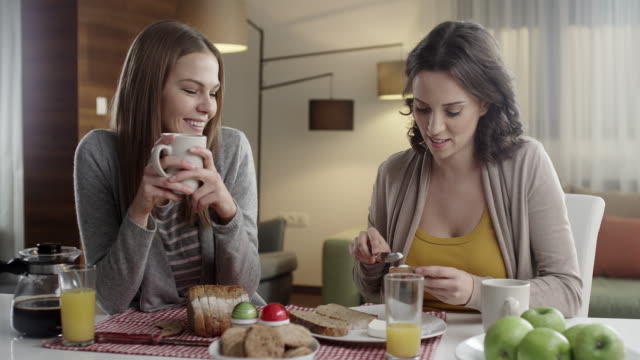 Friends talking and drinking coffee video