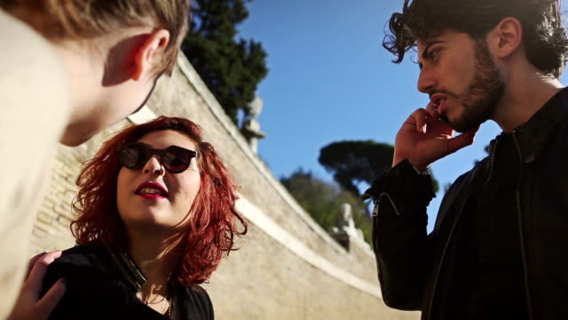 Friends talking outdoor Group of friends in Rome dyed red hair stock videos & royalty-free footage