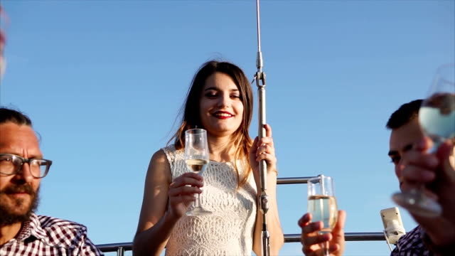 Friends toasting and having drinks during party on the yacht video