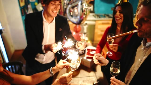 friends toasting at the party for the new year - new years stock videos & royalty-free footage