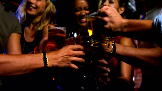 Friends toasting beer glasses video