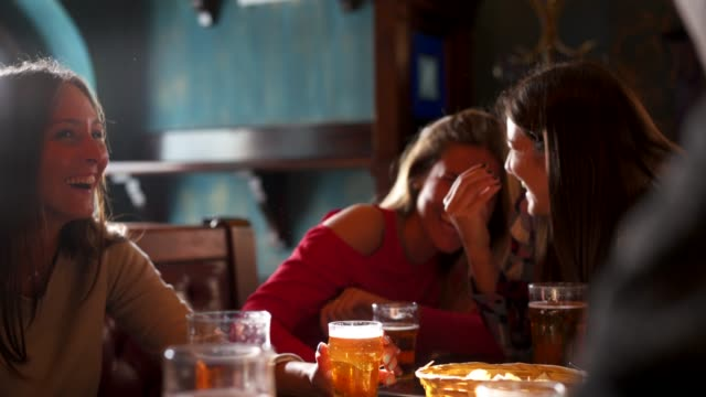 Friends together at the pub Friends together at the pub aperitif stock videos & royalty-free footage