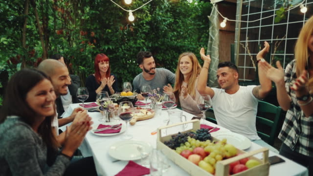 Friends together enjoy meal and red wine in Italy video