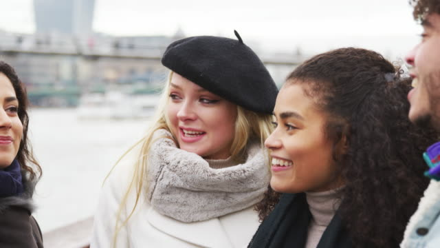 Friends Walking Along South Bank On Winter Visit To London video