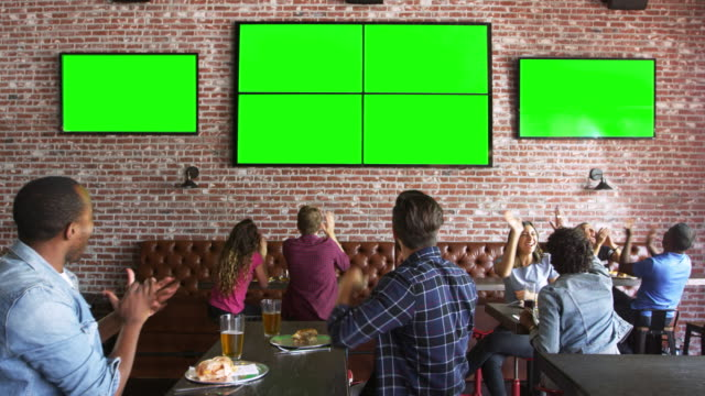 Friends Watching Game In Sports Bar On Screens Shot On R3D