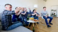 istock Friends watching winning football match 697935562