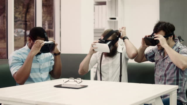 Friends wearing glasses of virtual reality video