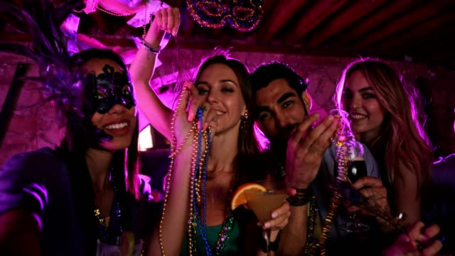 Friends with colorful beads celebrating Mardi Gras at New Orleans video