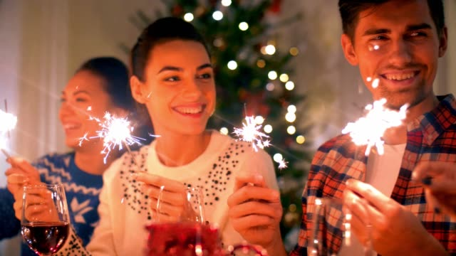 friends with sparklers at home christmas dinner - new years stock videos & royalty-free footage