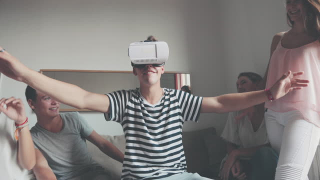 Friends with VR headset exploring virtual reality video