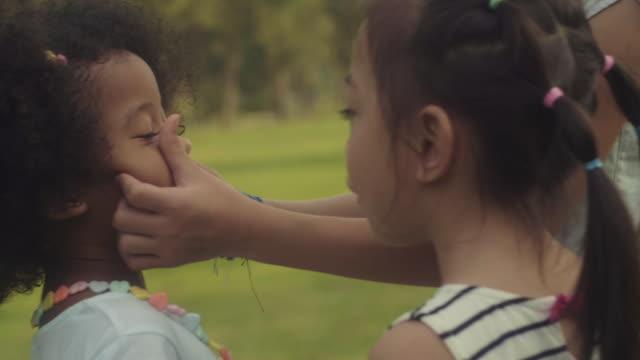 friendship - kids kiss embarrassed video stock e b–roll