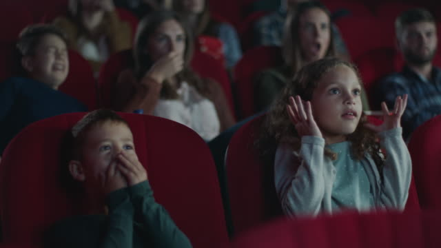 Frightened boy and girl in cinema
