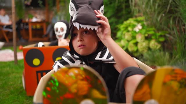 Frightened boy watching movie