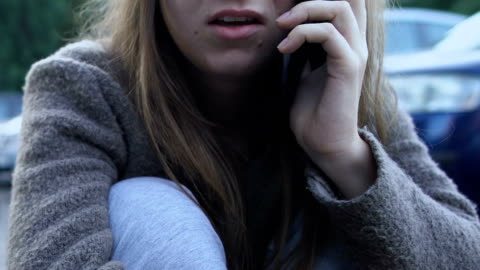 Frightened girl calling emergency, injured after road accident, state of shock Frightened girl calling emergency, injured after road accident, state of shock fear stock videos & royalty-free footage