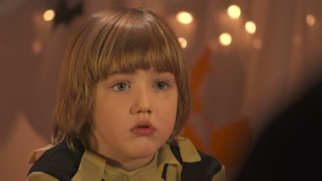 HD DOLLY: Frightened Little Boy Listening Halloween Stories video