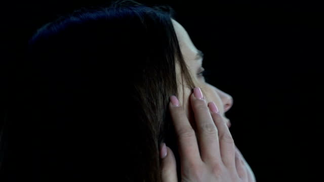 Frightened woman crying, helplessly looking around, road accident, slow-motion Frightened woman crying, helplessly looking around, road accident, slow-motion human trafficking stock videos & royalty-free footage