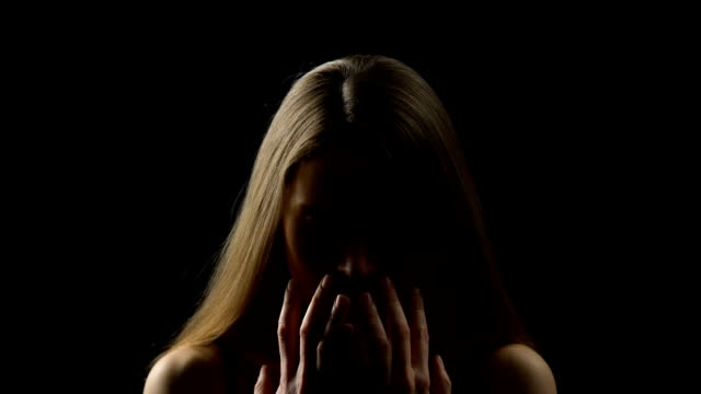 Frightened woman opening face with hands, rape victim, social insecurity concept Frightened woman opening face with hands, rape victim, social insecurity concept shivering stock videos & royalty-free footage