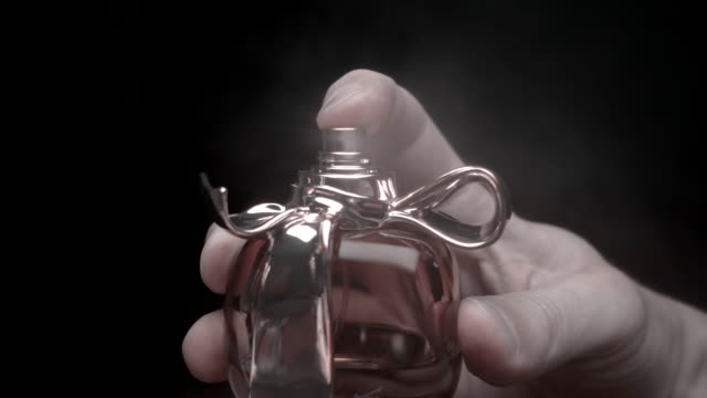 From perfume bottle the spirits fly straight into the camera. Slow mo, slo mo video