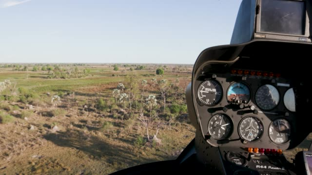 POV from pilot from the inside of a helicopter while flying over the Okavango Delta POV from pilot from the inside of a helicopter while flying over the Okavango Delta botswana stock videos & royalty-free footage