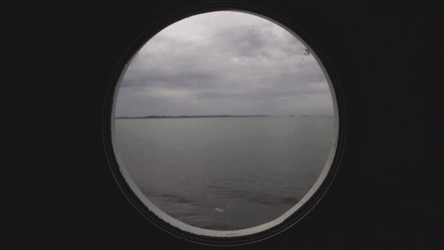 From the porthole window of a vessel in a calm sea video