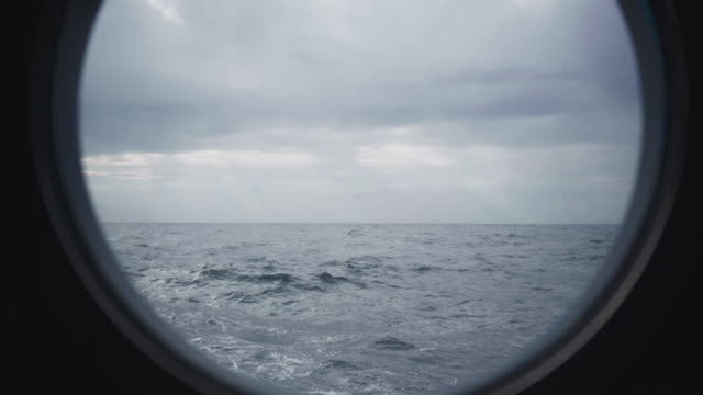 From the porthole window of a vessel in a rough sea video