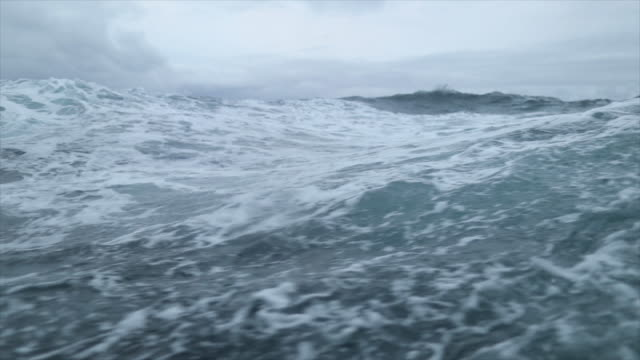 From the porthole window of a vessel in a stormy sea video