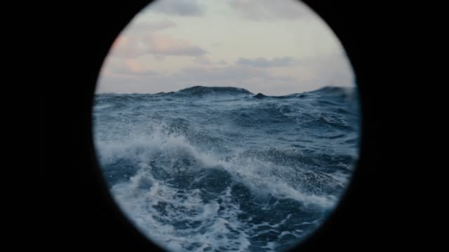 From the porthole window of a vessel in rough sea